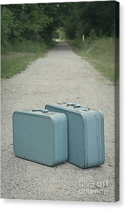Vintage Blue Suitcases On A Gravel Road Canvas Print by Edward Fielding