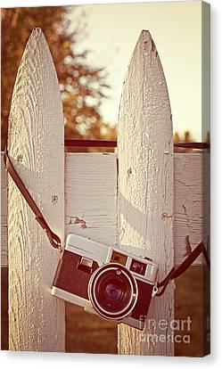 Vintage Film Camera On Picket Fence Canvas Print by Edward Fielding
