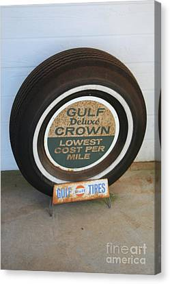 Canvas Print featuring the photograph Vintage Gulf Tire With Ad Plate by Lesa Fine