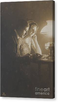 Vintage Loving Couple Reading With Oil Lamp Canvas Print by Patricia Hofmeester