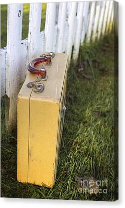 Vintage Luggage Left By A White Picket Fence Canvas Print by Edward Fielding