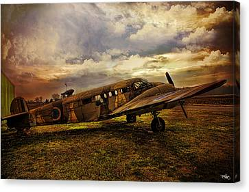 Vintage Plane Canvas Print by Evie Carrier