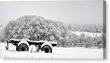 Vintage Wagon In Snow And Fog Filled Valley Canvas Print by Gary Whitton
