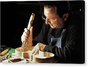 Violin-maker At Work Canvas Print by Patrick Landmann