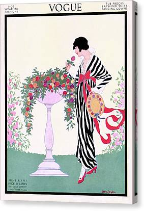 Gown Canvas Print - Vogue Cover Featuring A Woman Smelling A Rose by Helen Dryden