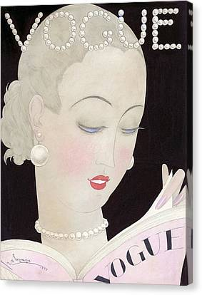 Vogue Magazine Cover Featuring A Woman Reading Canvas Print by Georges Lepape