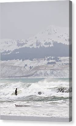 Wading Into Winter Surf Canvas Print by Tim Grams