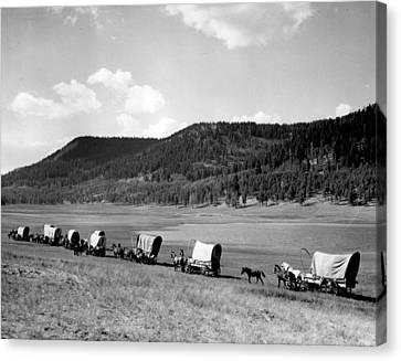 Wagon Train Canvas Print by Retro Images Archive