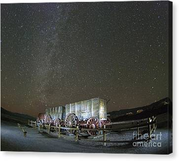 Wagon Train Under Night Sky Canvas Print by Juli Scalzi