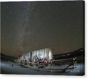 Wagon Train Under Night Sky Canvas Print