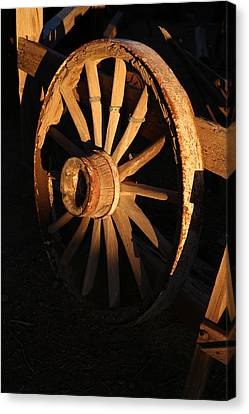Wagon Wheel At Sundown Canvas Print by Michael Hope