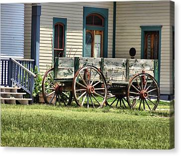 Wagon Wheels In Dodge City Canvas Print by Dan Sproul
