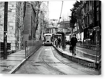 Waiting For The Tram In Istanbul Canvas Print by John Rizzuto