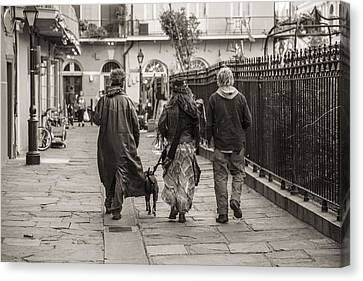 Walking In New Orleans Canvas Print by John McGraw