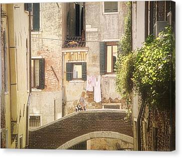 Walking In Venice Canvas Print by Nicola Nobile