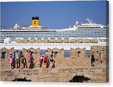 Walking On The Fortification Of The Medieval City Of Rhodes Canvas Print by George Atsametakis