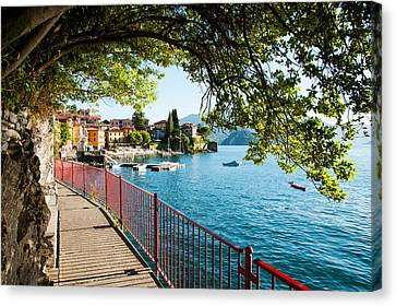 Walkway Along The Shore Of A Lake Canvas Print by Panoramic Images