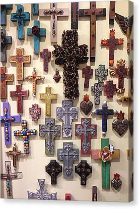 Crucifixes Canvas Print by Julio Lopez