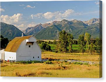 Wallowa Mountains And White Barn Canvas Print by Nik Wheeler