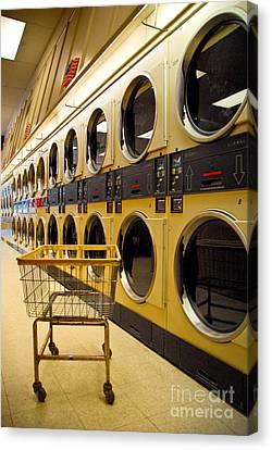 Washing Machines At Laundromat Canvas Print by Amy Cicconi