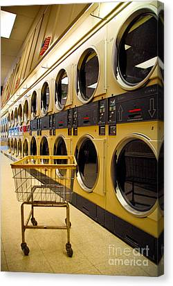 Washing Machines At Laundromat Canvas Print by Amy Cicconi