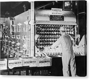 Washing Milk Bottles Canvas Print by Underwood Archives