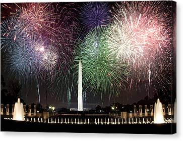 Washington Monument And Wwii Memorial Under Fireworks  Canvas Print by Regina  Williams