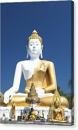 Wat Doi Kham Temple Buddha Chiang Mai Canvas Print by Stuart Corlett