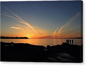 Watching The Sun Go Down Canvas Print by Randy Hall