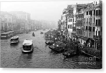 Water Bus On The Canal Canvas Print by John Rizzuto
