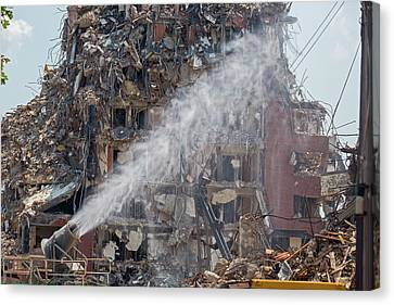 Water Spraying At Demolition Site Canvas Print by Jim West