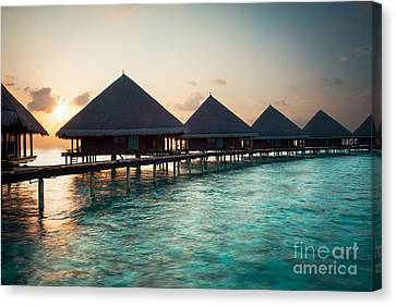 Waterbungalows At Sunset Canvas Print by Hannes Cmarits