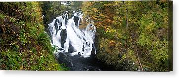 Waterfall In A Forest, Swallow Falls Canvas Print by Panoramic Images