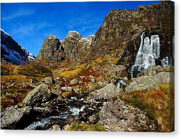 Waterfall In Autumn Mountains Canvas Print by Gry Thunes