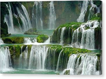 Waterfall In Green Canvas Print by Charline Xia