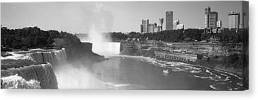 Waterfall With City Skyline Canvas Print by Panoramic Images