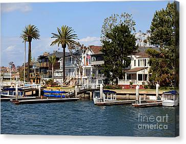 Waterfront Luxury Homes In Orange County California Canvas Print by Paul Velgos