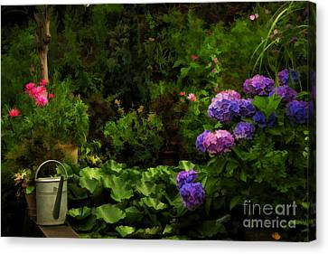 Watering Can In A Beautiful Garden Canvas Print