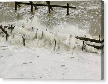 Waves Crashing Against The Sea Defences Canvas Print by Ashley Cooper