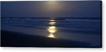 Waves Reflecting Moon Canvas Print by Amanda Holmes Tzafrir