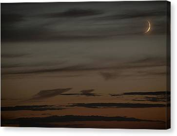 Waxing Crescent Moon Over Purple And Orange Evening Sky Canvas Print by Julis Simo