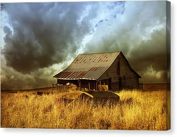 Weathered Barn  Stormy Sky Canvas Print by Ann Powell