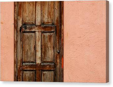 Weathered Door On Peach Stucco Canvas Print by Rob Huntley