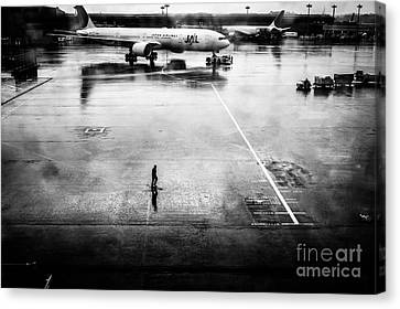 Wet Tarmac Canvas Print by Dean Harte