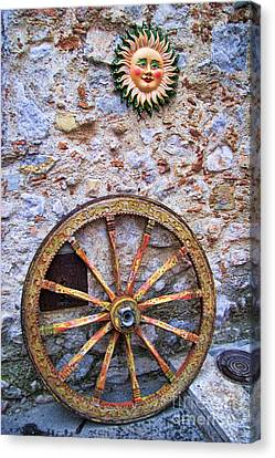 Wheel And Sun In Taromina Sicily Canvas Print by David Smith