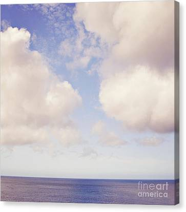 When Clouds Meet The Sea Canvas Print by Lyn Randle
