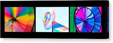 Whirligig Tryptych Black Background Canvas Print by David Smith
