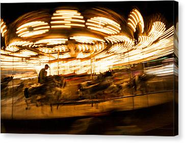 Whirling Carousel With Rider Canvas Print by Aaron Baker