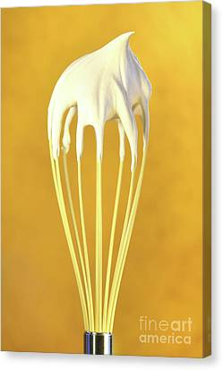 Whisk With Whip Cream On Top Canvas Print by Sandra Cunningham
