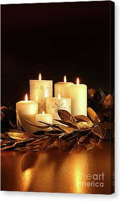 White Candles With Gold Leaf Garland  Canvas Print by Sandra Cunningham